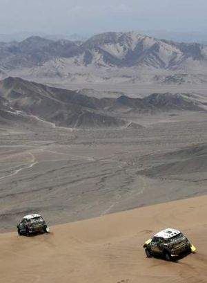 Out in front: France's Stephane Peterhansel (L) leads Spain's Nani Roma during the 12th stage of the Dakar Rally from El ...