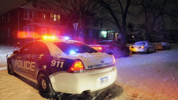 A Detroit Police vehicle is parked in the neighbourhood where a four-year-old boy was shot with a rifle by his ...