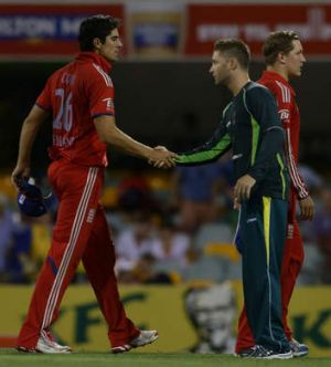 Compounding misery: Alistair Cook congratulates Michael Clarke after the loss.