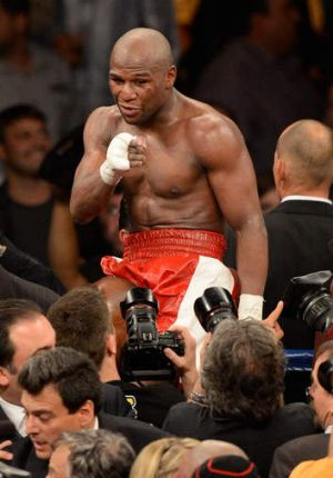 Mayweather celebrating after defeating Miguel Cotto in 2012.