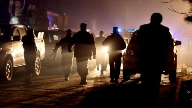 Foreigners targeted: Afghan security forces at the restaurant where the bomber struck.