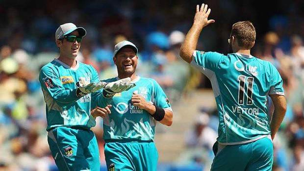 Daniel Vettori (back to camera) celebrates with wicketkeeper Craig Kieswetter and Ryan Harris after getting the wicket ...