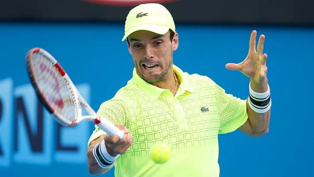 Roberto Bautista Agut plays a forehand during his third-round match against Benoit Paire of France.