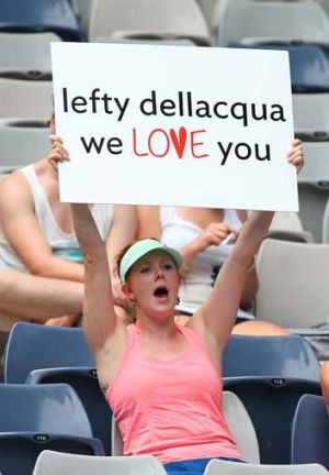 A fan holds up a sign in support of Casey Dellacqua.