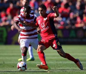 Youssouf Hersi of the Wanderers contests the ball with Marcelo Carrusca of Adelaide United