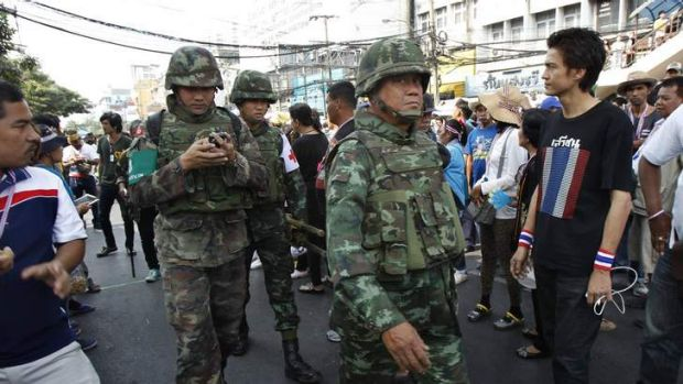 Civil unrest: Thai military medics head to the scene of an explosion at an anti-government protest camp at the Victory ...