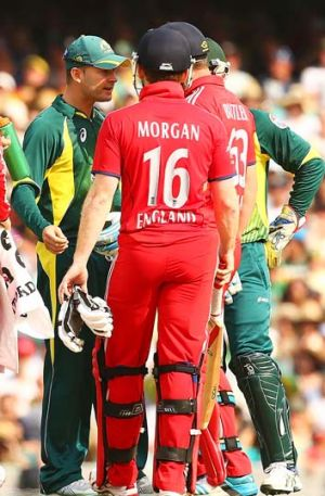 Stand-off: Michael Clarke has words with Eoin Morgan and Jos Buttler after Morgan stood his ground.