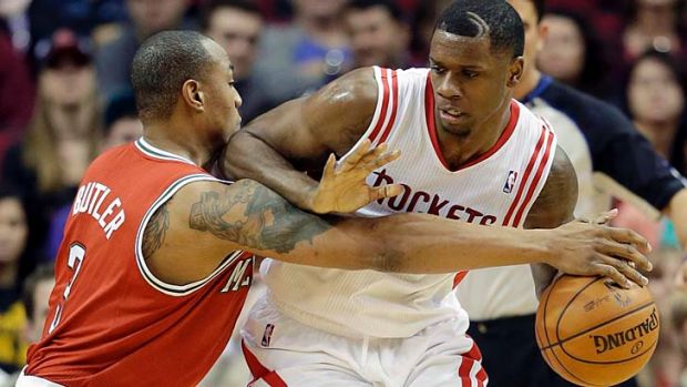 Caron Butler of the Milwaukee Bucks tries to steal the ball from Terrence Jones of the Houston Rockets.