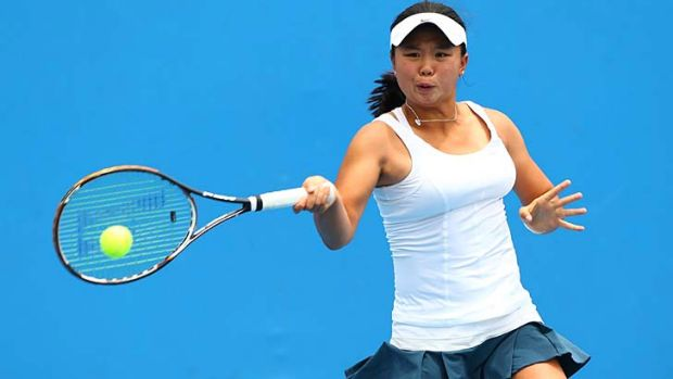 Face of the future: Olivia Tjandramulia plays a forehand in her first-round junior girls' match against Nozomi Ohya of ...