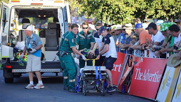 Giovanni Visconti is carried into an ambulance after crashing during day one of the Tour Down Under on Sunday.