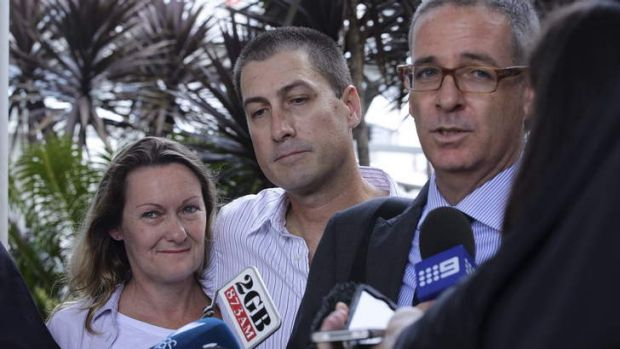 Back home: Marcus and Julie Lee, with their lawyer John Sneddon at Sydney Airport.