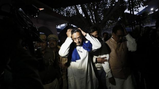 Shashi Tharoor walks away after performing the last rites for his wife Sunanda Puskhar Tharoor at a cremation ground in ...