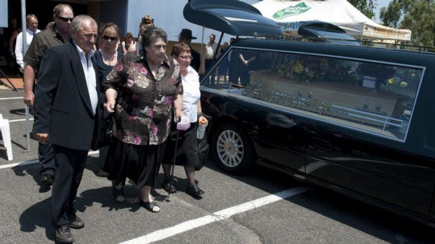 Jean Bischoff (centre) is walked out by family members after the Funeral for Noelene and Yvana Bischoff in Gatton ...