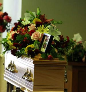 GATTON, AUSTRALIA - JANUARY 20: Flowers cover the coffins at the funeral of Noelene and Yvana Bischoff at the Gatton ...