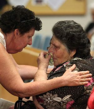 Jean Bischoff, right, is comforted by a friend at her daughter and granddaughter Noelene and Yvana Bischoff's funeral at ...