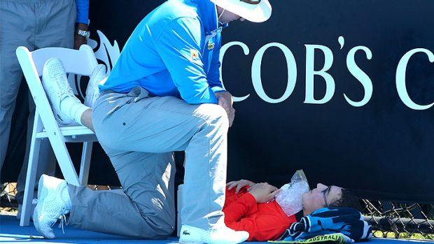 """Heat takes its toll on a ballboy at the Australian Open: officials invoked the tennis tournament's """"extreme heat policy""""."""