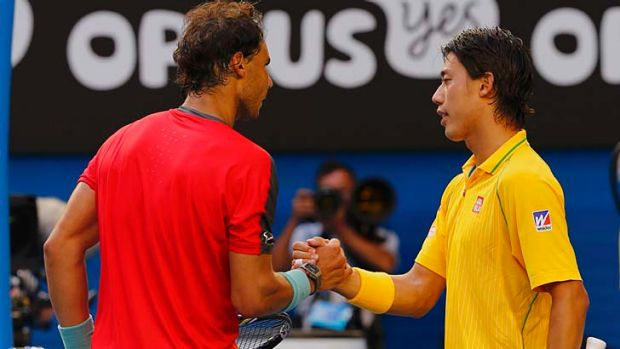 Ever the gentleman: Rafael Nadal wishes Kei Nishikori well after defeating the Japanese contender in straight sets.