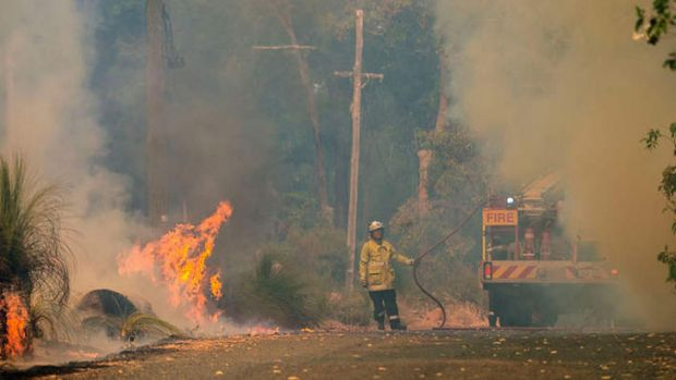 Fire crews battling flames in Parkerville earlier this month.