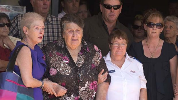 Grief: Noelene Bischoff 's mother, Jean, leaves the funeral.