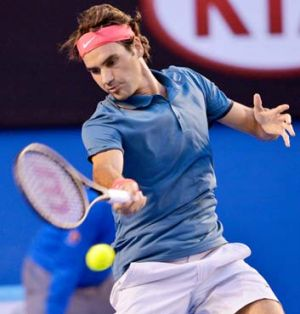Roger Federer dishes out a forehand against Jo-Wilfried Tsonga.