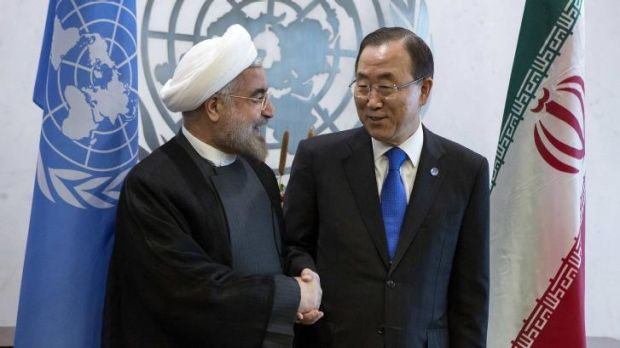 United Nations Secretary-General Ban Ki-moon greets Iran's President Hassan Rouhani during the UN General Assembly in  ...