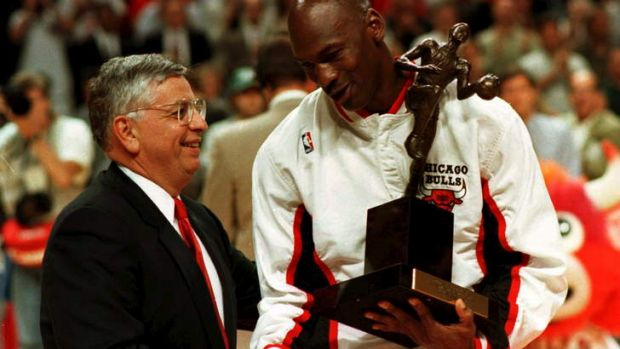 NBA commissioner David Stern congratulates Chicago Bulls guard Michael Jordan as he is presented with the 1996 NBA Most ...