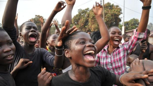 Residents celebrate the election of Bangui's mayor as  interim president of the Central African Republic.