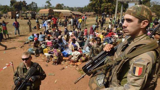 French soldiers stand guard as Muslim people wait to seek refuge at the Boali church, 100km north of Bangui.