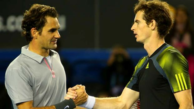 Last year in Melbourne: Andy Murray commiserates with Roger Federer after defeating him in the semi-finals in 2013.