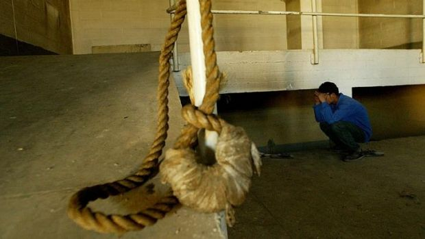 Long history of capital punishment ... A hanging noose rests on a rail as a Iraqi teenager inspects the gallows in the ...