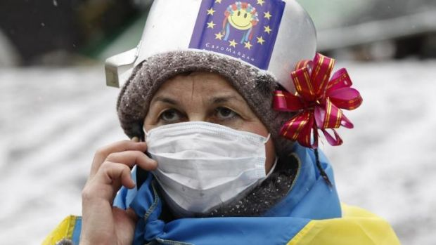 A demonstrator speaks on the phone during a rally held by pro-European integration protesters in Kiev.
