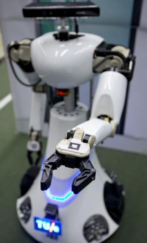 Amigo, a white robot the size of a person. The US Army is considering replacing soldiers with robots.