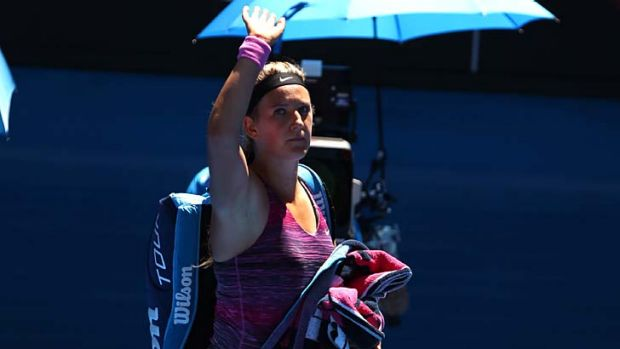 Over and out: Victoria Azarenka walks off court after her quarter-final loss.
