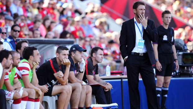 Character building: Tony Popovic looks pensive on the sidelines during the Wanderers' 1-0 loss to Adelaide at Coopers ...