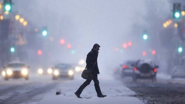 Caught in a blizzard: a man crosses the road in Philadelphia.