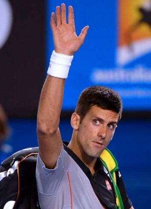 See you in 2015: Novak Djokovic walks off sadly.