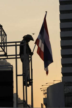 A media camera drone above an anti-government protester in Thailand.