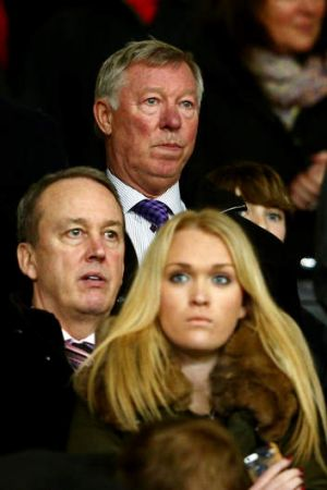 Grim watching: Former Manchester United manager Sir Alex Ferguson looks on from the stands.