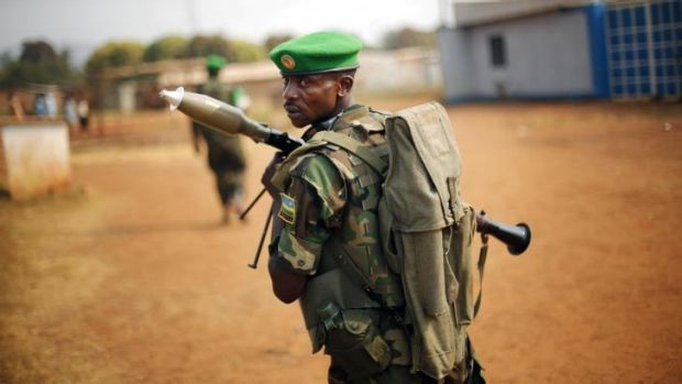 On patrol: A Rwandan soldier from the African Union peacekeepers on the streets of Bangui.