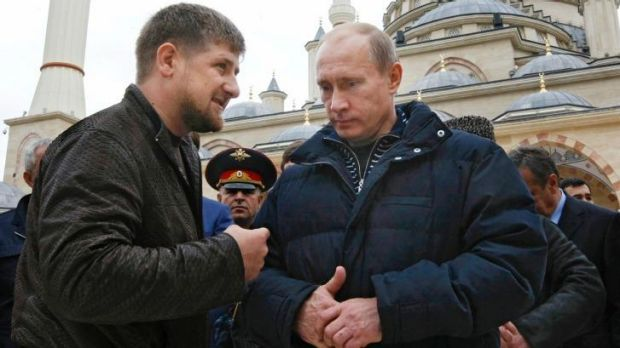 Allies: Russian Prime Minister Vladimir Putin, right, listens to Chechen President Ramzan Kadyrov in Grozny, Chechnya.