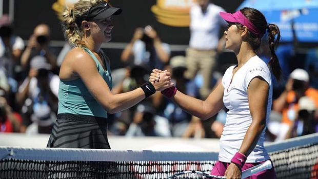 Li Na of China, right,  shakes hands with Canadian Eugenie Bouchard.