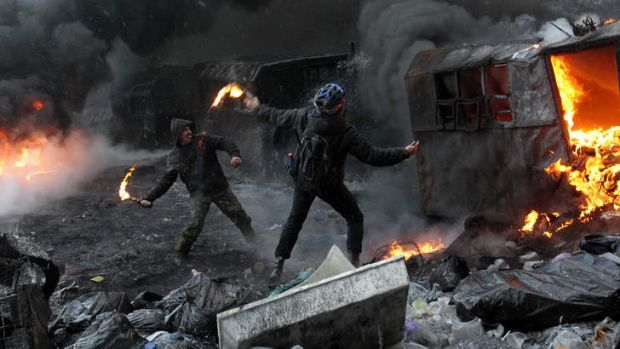 Protesters clash with police in central Kiev.