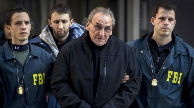 Alleged mobster Vincent Asaro is escorted by FBI agents from their Manhattan offices in New York.