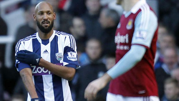 French striker Nicolas Anelka gestures as he celebrates scoring their second goal during the English Premier League ...