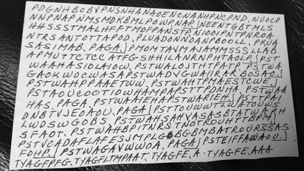 Code cracked: the front of an index card filled with letters written by Dorothy Holm.