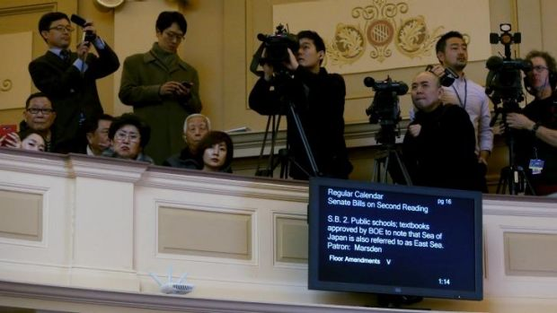 Korean and Japanese media in the Senate gallery for the upper house vote on the bill.