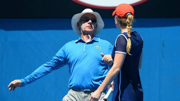 Line of fire: Alize Cornet collides with a line judge at the Australian Open.