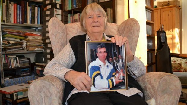 Elizabeth Roebuck, 85, holds a picture of son Peter as she fights to remove shadows hanging over his reputation.