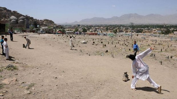 Afghan boys play cricket near a cemetery in Kabul. Attacks on people participating in sport were common when the Taliban ...