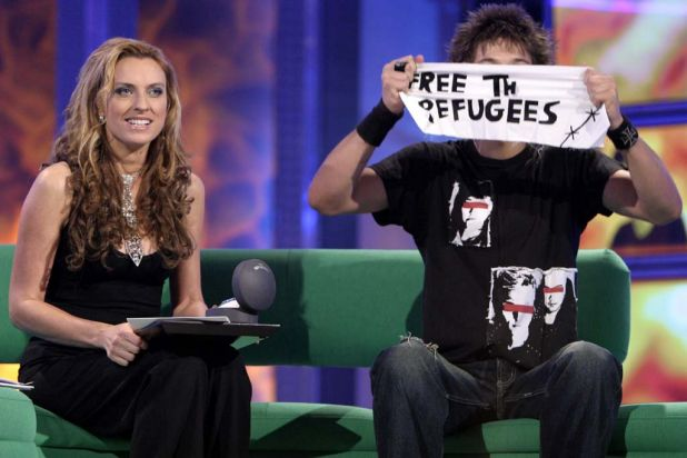 Gretel Killeen and Merlin Luck with his call to free refugees, which he snuck into the Big Brother house.